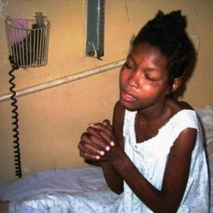 Patient praying at the hospital in Pignon.