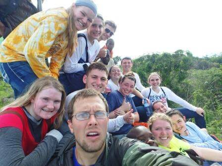 "Here is us doing our best ""Oscar Selfie"" on top of the mountain."