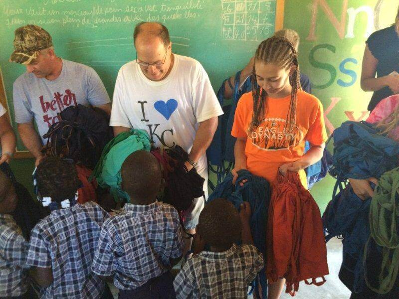 Handing out backpacks