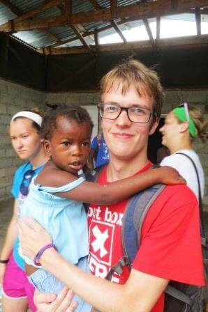 Hunter and Jenny, one of the little girls at the orphanage.