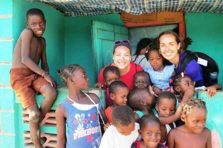 Melanie and Hannah  snap a picture with the many, many children of Haiti.