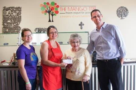 Donation to the Ecumenical Cupboard. Pictured left to right: Liz Clarke, Abbas, Shirley Frey , and Tim Brand