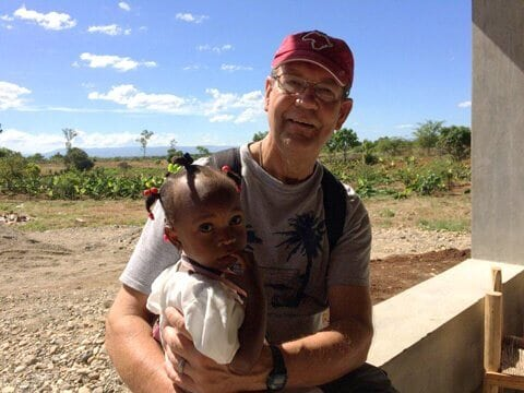 Henry Allen, with one of the Thrive children in Sylvain.
