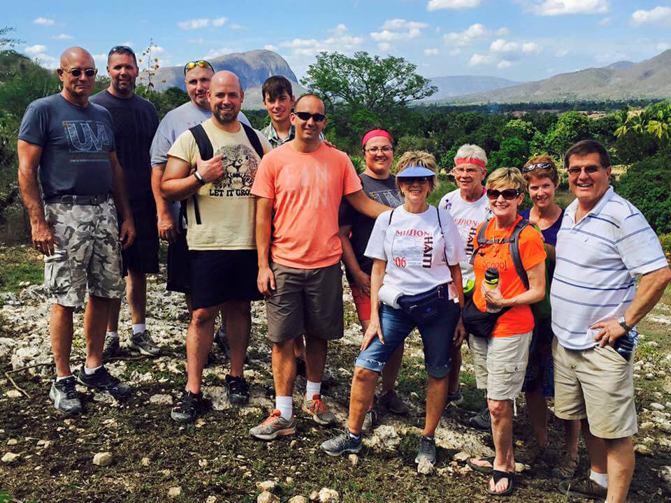 Group overlooking valley after VBS and scholarship kids processed at Guimby