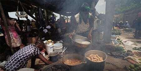 Ladies prepare food at the market.