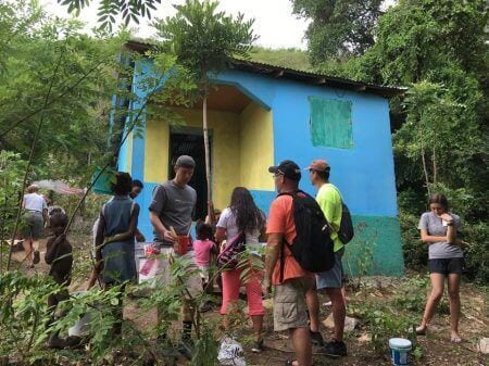 Volunteers view a colorful house.
