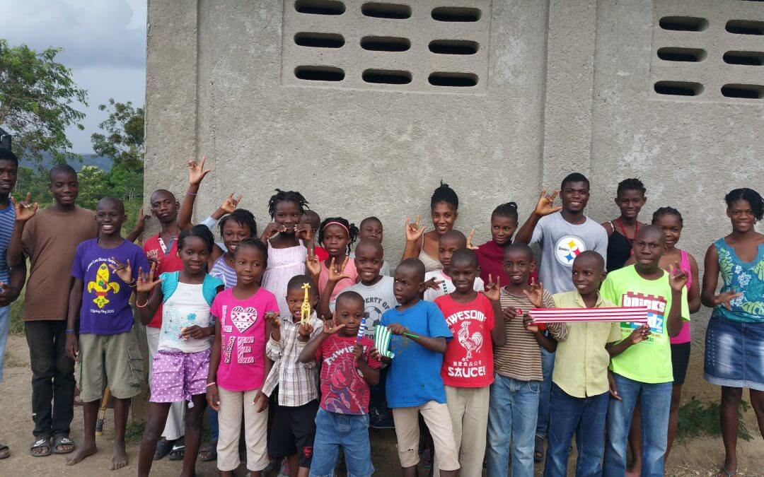 Students at the deaf school pose.
